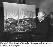 "A.Y. Jackson, member of the ""Group of Seven"" (1919-1933) painting in his studio in 1944."